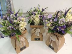 Pretty Bridesmaids Bouquet Trio in rustic boxes with hessian and lace. Wildflower style in lilac, lavender, purple and cream.