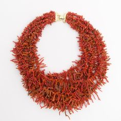 Playing with coral colours and textures in this necklace from