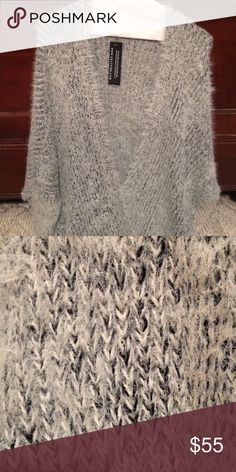 """Ekattire - Perfectly cozy furry cardigan. Reposh from another Posher..  (Last photo is from itselaines closet).  Open front, no pockets, side slits.   Length from shoulder to hem 33"""".   Dolman sleeves.  One Size.   I think it's more on the large side, but that depends how you like to wear your cardigans.   I paid $50 plus shipping so my price is firm.  It has not been worn. ekattire Sweaters Cardigans"""