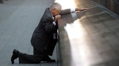 Robert Peraza pauses in front of his son's name on the 911 Memorial during the tenth anniversary ceremonies at the site of the World Trade Center.