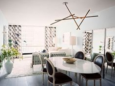 The Iconic Saarinen Tulip Table - The less seen oval shape. I love these chairs with the table