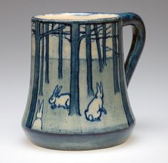 Mug with rabbits in a forest design, ca by Amelie Roman and Joseph Meyer Collection of Caren Fine On view in the Smithsonian traveling exhibition Women, Art, and Social Change: The Newcomb Pottery Enterprise click now for info. Pottery Mugs, Ceramic Pottery, Pottery Art, Ceramic Cups, Ceramic Art, Forest Design, Rabbit Art, Bunny Art, Le Far West