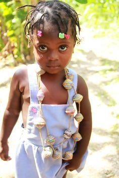 Beautiful Haitian girl modeling handmade jewelry from papillon-enterprise.com