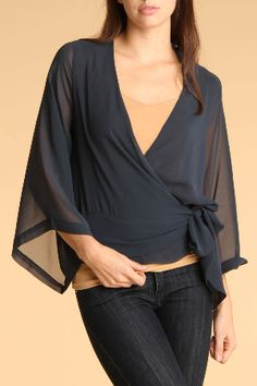 nice kimono style top - something like this is great because it will soften your shoulders, it wraps at the waist and you could easily put it over all kinds of dresses