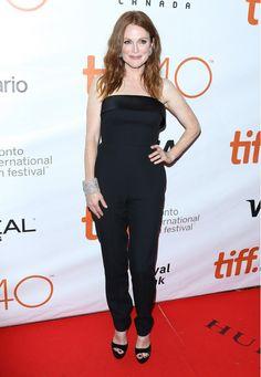 Julianne Moore wears a black tuxedo jumpsuit with satin trim, Chopard jewelry, and black platform sandals