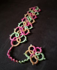 """My first tatting design for a bookmark. Inspiration from OneVirtuousWoman on youtube """"tatted bracelet"""", Heavily modified. And I also added a tail with a Josephine chain & a flower on the end. I'm very happy with it. I haven't blocked it yet. This one is for Mum for Christmas. I am making Dad one in different colour - way. Ill post when it's finished :) I will share pattern, comment & ill send you the pattern,thread size & needle. Please like it! :)"""