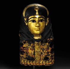 AN EGYPTIAN GILT CARTONNAGE MUMMY MASK   Late Ptolemaic to Early Roman Period  1st Century B.C.-1st Century A.D.