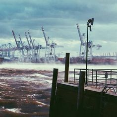 hamburg  harbour cranes in the storm