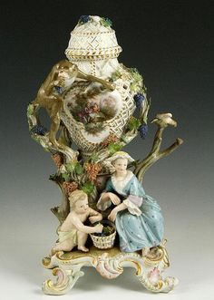 "19th century Meissen figural perforated vase, with lid, 12 1/2""h. Some damage."
