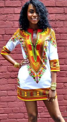 Stunning Old School Ankara Styles For Your Work Days - MOMO AFRICA Dashiki Shift Dress White Dashiki Shift Dress White. The Dashiki Shift dress is made from a gorgeous printed cotton fabric fashioned with a V neck and three quarter length sleeves. African Dashiki Dress, Kente Dress, African Fashion Ankara, Ghanaian Fashion, African Inspired Fashion, African Print Dresses, African Print Fashion, Nigerian Fashion, African Prints
