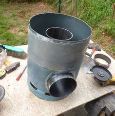 Gas tank rocket stove - parts being assembled Diy Rocket Stove, Rocket Mass Heater, Rocket Stoves, Cooking Stove, Fire Cooking, Stove Oven, Cooking Light, Diy Wood Stove, Walk In Freezer