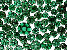 """Trapiche emeralds display six spoke-like carbon """"rays"""" emanating from a hexagonal center with the areas in between filled with lively emerald green. Beautiful and natural phenomenon."""