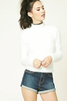 A fuzzy knit sweater featuring a high neckline and long sleeves.