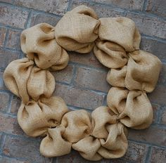 How to Make a Burlap Wreath. I can think of so many different simple things to add to this plain looking wreath!