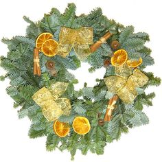 Beautiful wreath made from real Noble Fir foliage. Lovingly hand decorated with natural decorations. 14 inch diameter. The dried fruits mixed with the natural foliage combine to make a wonderfully Christmas scented wreath.