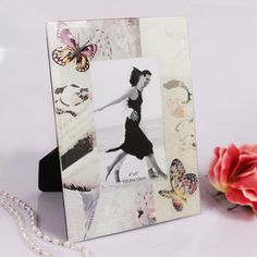"""Ruby Blanc's """"Capturing Cheer Photo Frame """"will decorate your event with butterflies, and gracefully display their cheery memories. Make them smile by presenting them with this fantastic photo frame! #weddingfavors"""