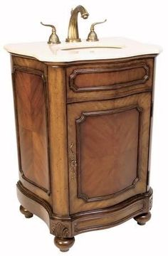 A beautiful petite sink chest with delicate carving finished in a rich mahogany and an Ivory Cream marble top. www.mkhomedesign.com