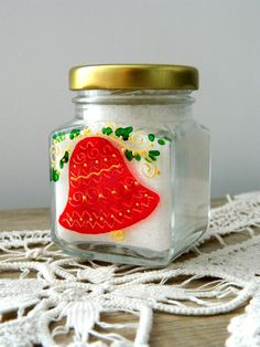 Hand painted Christmas jar filled with orange flavoured sugar.