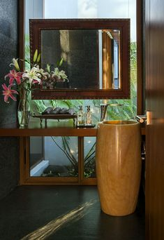 Powder room with glass wall and ample natural light