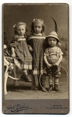 Three cute children.  Love the matching girls dresses.Gorgeous!