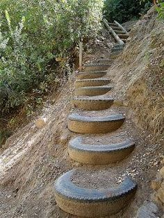 "Recycled tires outdoor stairs, This would be good for Ruidoso!!! [   ""Could be a great use for some of the old tires. Steps going up to the road"",   ""Could be a great use for some of the old farm tyres ~ segue from my kitchen garden to orchard!! Grow ground cover around and under each tyre to prevent erosion........AJ Recycled tires outdoor stairs (DIY) Outdoor Furnit"",   ""Reusing old tires. Down the hill through the woods to the creek?"",   ""Recycled tires outdoor stairs on steep hillside…"