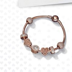 791e7615d Make someone's heart skip a beat with this new snake chain bracelet and  exquisitely crafted charms in PANDORA Rose, our unique metal blend with a  gorgeous ...