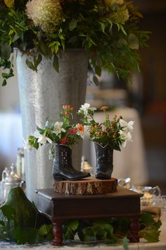 Vince Gill event mini cowboy boot centerpieces filled with flowers