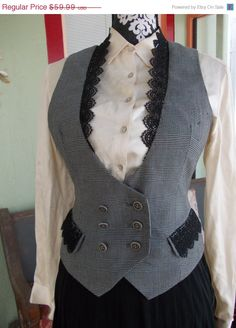 The Grey Tweed and Lace Vest is a One of a Kind Upcycled Steampunk Vest in Womens MEDIUM-LARGE. This beautiful waistcoat has a tailored look and