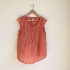 Lauren Conrad Sheer coral bow top Beautiful and wispy for those hot summer days. Features flutter sleeves and tucks/bow detail on front. Lauren Conrad Tops Blouses