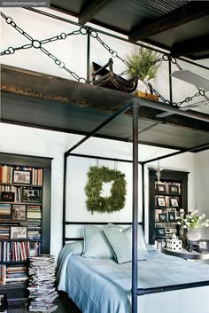 Great idea of putting a wreath above the bed to make every room part of your beautiful holiday decor.
