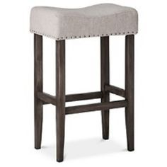 Simple, yet highly stylish, the Threshold Linen Saddle Barstool is a smart accent to your home. This piece of furniture is the perfect addition to your bar, kitchen island or tall bistro table thanks to its minimalist design with a touch of country flair. Counter Stools, Bar Stools, Bar Chairs, Island Stools, High Chairs, Grey Hardwood, Furniture Legs, Kitchen Decor, Bar Kitchen