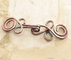 Handmade Celtic knot copper cardigan clasp or sweater clasp for knit and fabric - select other metal finish. $9.00, via Etsy.