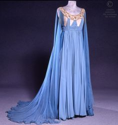 Opera National de Paris Robe in blue crepe, belted high waist, with sleeves chiffon crepe scarves. Base tulle embroidered flesh blue stones and gold beads. Small train attached at center back.