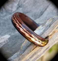 ebony bent wood ring with copper twisted copper inlay