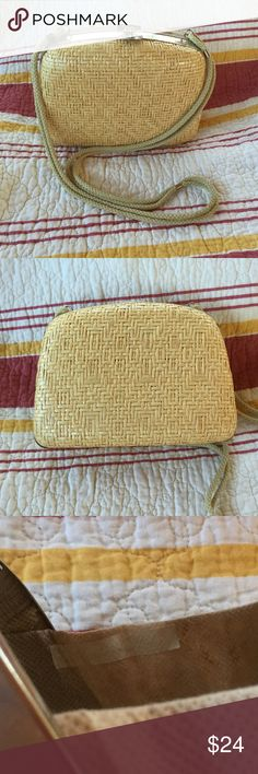 Vintage 60s/70s? Blonde Wicker Italian Crossbody This is a summery fun light tan, off white, ivory, cream woven wicker cross body purse. We are guessing the vintage to be 1960s or 1970s. The hardware is silver tone. The inside is not particularly attractive. The lining has aged and you can see the shadow of the glue they used. The outside is perfect. 8 in wide, 6 in high 3 in deep. (746) Vintage Bags Crossbody Bags