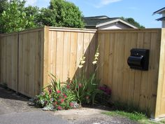 Wooden (timber) shiplap fence, with built-in letterbox, built by Auckland Fences.