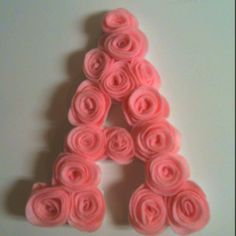 Felt roses glued to white wood letter... Perfect for a baby room