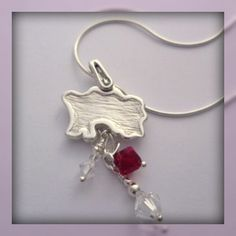 Fine silver Jersey pendant....1st silver clay commission