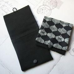Pochette de sac noire et kaki motif ethnique