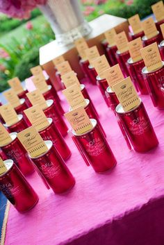 escort cards - attached to champagne cans? Yes, please!