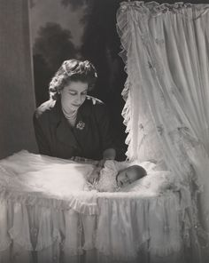 Photograph by Cecil Beaton / On  November 14, 1948 Princess Elizabeth gave birth to her first child, Prince Charles Philip Arthur George. At her mother's suggestion, the Princess chose Beaton to photograph her newborn son. Beaton later took photographs commemorating the births of her other children: Princess Anne (1950), Prince Andrew (1960) & Prince Edward (1964). Beaton's portraits depicted the Queen as a tender figure.