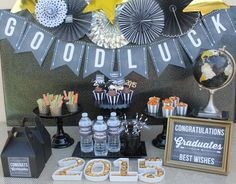 Graduation Table Ideas graduation table decorations ideas graduation centerpieces pails with cap and year decorations graduation table centerpiecesgraduation decorationsparty 10 Fun Graduation Party Ideas