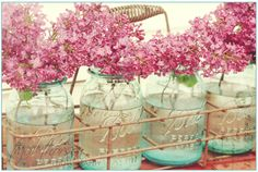 lilacs + blue Ball jars + old carrier = love, love, love