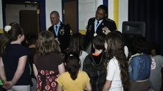 Rock Island Arsenal Sergeant Audie Murphy Association members spoke to Franklin Elementary, Moline, Ill., about being the best you can be and striving for excellence on April 5. The president of the RIA SAMA, Sgt. 1st Class Darrick Dupree and recent inductee, Sgt. 1st Class Matthew Favory, were honored guest speakers as part of the school's Quality Coin program.
