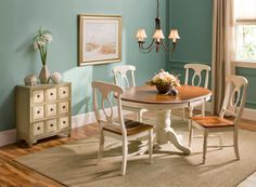 This dining set also features more formal design elements, like a gorgeous pedestal table base and keyhole chair backs. And if you're space conscious, you'll appreciate the table's self-storing butterfly leaf—it provides extra table space when you need it and can easily be stowed out of sight when you don't!