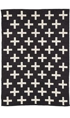 Shop Indoor + Outdoor Rug (Black).  What are the pluses and minuses of this rug? Well, it features a bold, design, so that's a plus.  It can also be used anywhere from the playroom to the patio, so that's a bigger plus.
