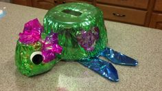 Turtle Valentine's Box - used upside-down tupperware (w/ lids) from the dollar store for the head & body, then cardboard for the fins & tail.  Wrapped all in colored cellophane.