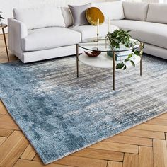 Part of our Distressed Heirloom collection, the hand-loomed Echo Print Rug's intricate motif is our modern interpretation of classic Egyptian patterning. Each rug has a luxe, hand-knotted feel, will vary in depth of color and has a hint of shine to… Beach Living Room, 5 Seater Sofa, Circle Rug, Modern Rugs, Modern Living, Engineered Hardwood, Large Rugs, Cool Rugs, French Country Decorating