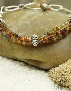 http://earthwhorls.com/collections/bracelets/products/1552sb  Tourmaline and sterling silver bracelet - celebrating the beauty of nature and the fun of fashion.