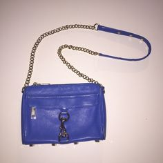 Rebecca Minkoff Mini Mac Crossbody Authentic Rebecca Minkoff Mini Mac in a rare blue color with gold hardware! Great condition (some general signs of wear in pictures), great price!   I'll only consider offers made with the offer button. No trades or low ball offers. My items are already extremely discounted and sell very fast. So, if you see something you like... make an offer! ❤️  Thanks for looking around my closet! I am always adding new items!   BUNDLE & SAVE 10%!  Top 10% rated…